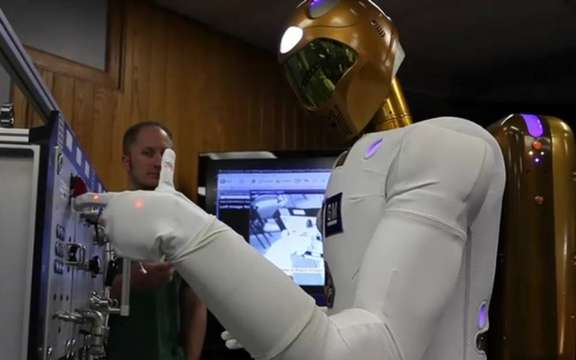 The humanoid Robonaut 2 GM takes its place at the International Space Station