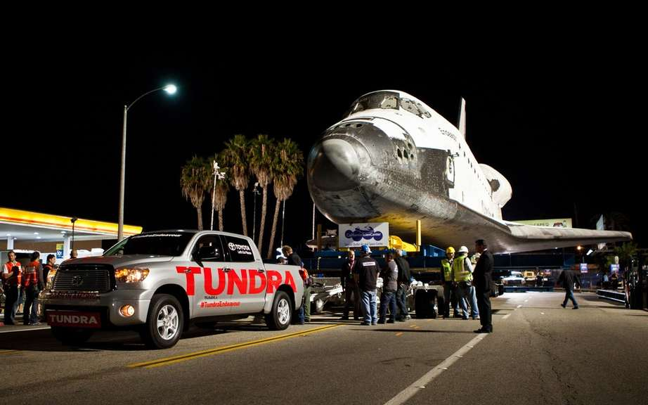 The Toyota Tundra passes history towing an icon space picture #1