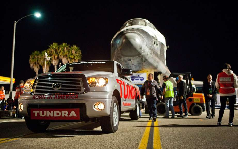 The Toyota Tundra passes history towing an icon space picture #2